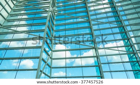 Business building windows and sky reflection