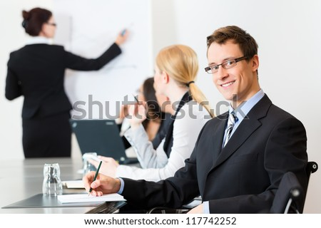 Business - businesspeople have a meeting or workshop with presentation in office - stock photo