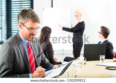 Business - businesspeople have a meeting with presentation in office, they negotiate a contract - Portrait of a businessman - stock photo