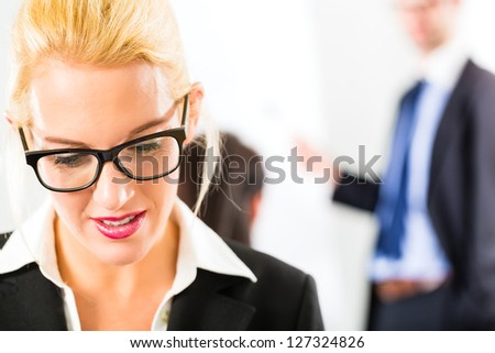 Business - businesspeople have team meeting or workshop in an office - Portrait of a businesswoman - stock photo