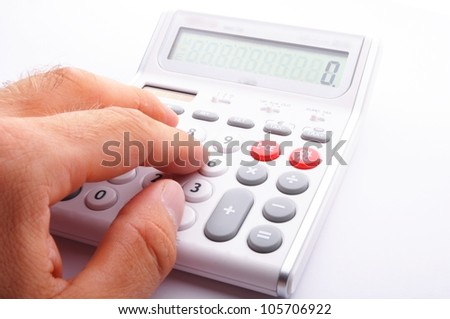 business calculation concept with modern white calculator