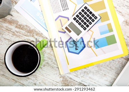 Business calculations and analytics in the office.