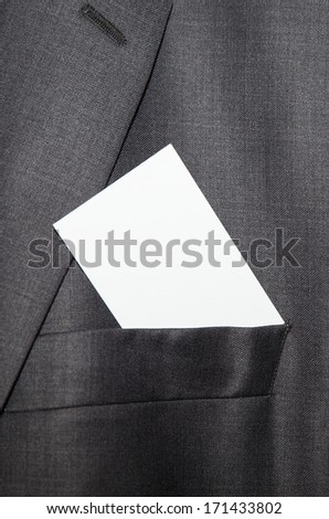 Business card being placed in pocket - stock photo
