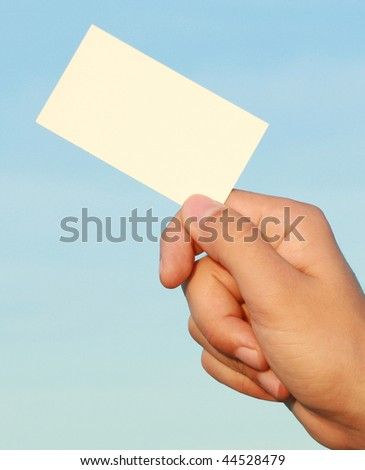 business card in a man's hand - stock photo