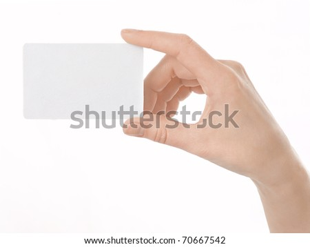 Business card in female hand. Studio isolated.