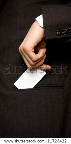 Business card in the pocket of a suit - stock photo