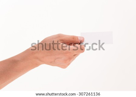 Business card is given to someone by man's hand. Blank card is transmitted by man's right hand to his collegues or partners. - stock photo