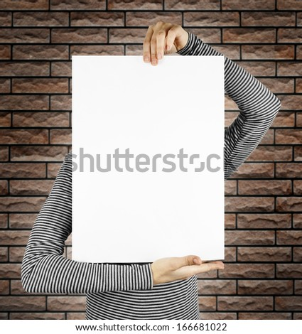 business card isolated in a hand on the brick backgrounds - stock photo