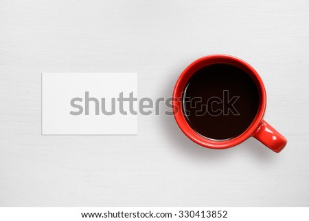 Business card mock-up and coffee cup top view - stock photo