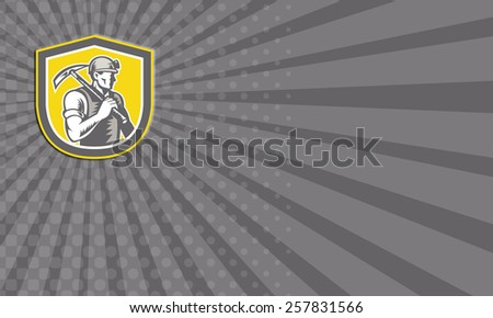 Business card showing illustration of a coal miner wearing hardhat with pick axe facing side set inside shield crest done in retro woodcut style. - stock photo