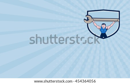 Business card showing illustration of a mechanic lifting giant spanner wrench over head viewed from front set inside shield crest on isolated background done in cartoon style.  - stock photo