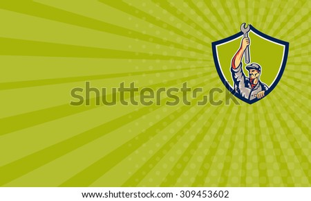 Business card showing illustration of a mechanic lifting raising up spanner wrench looking to the side viewed from front set inside shield crest on isolated background done in retro style.  - stock photo