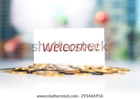Business card. Welcome card and coins on a table. - stock photo