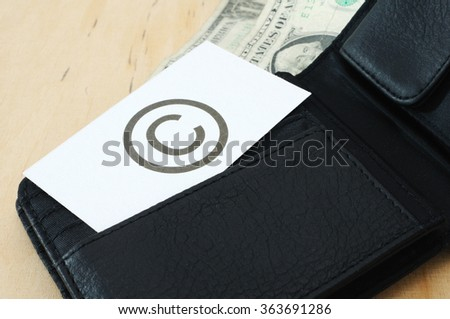Business card with the sign COPYRIGHT in wallet with dollars   - stock photo