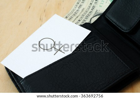 Business card with the sign FEMALE SEX in wallet with dollars  - stock photo