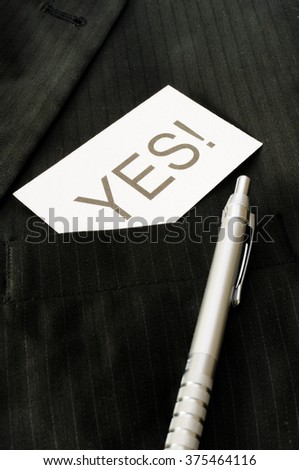Business card with the sign YES!  - stock photo