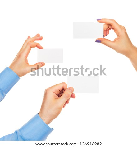 Business cards in hands on white background - stock photo