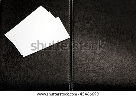 Business cards on a leather briefcase. Isolated on white. - stock photo