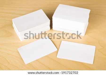 Business cards with rounded corners. Stack of blank horizontal business cards propped up another with copy space for your design. - stock photo