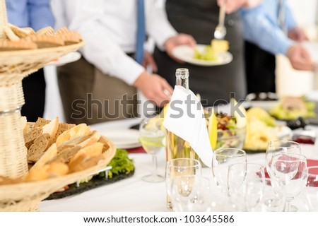 Business catering people serving themselves buffet at company meeting - stock photo