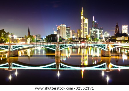 Business center Frankfurt at night reflecting in the water - stock photo