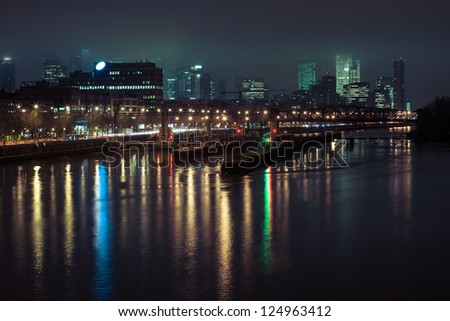 Business center in Paris at night in the fog - stock photo