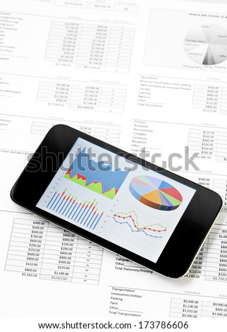 Business chart on mobile phone - stock photo