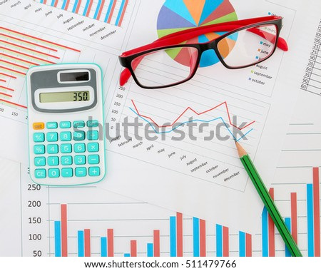 Business chart with calculator, pencil and glasses.
