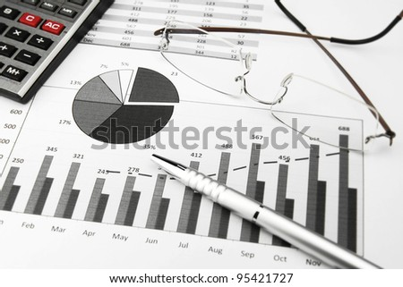 Business Charts Black and White with calculator, glasses and pen - stock photo