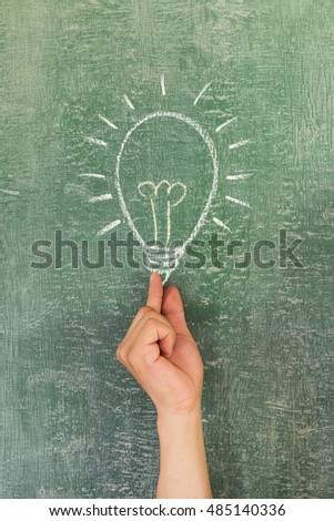 Business charts with arrow upwards handwriting with chalk on blackboard
