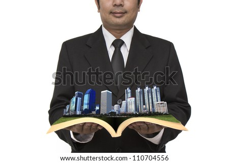 Business city center in businessman's hand - stock photo