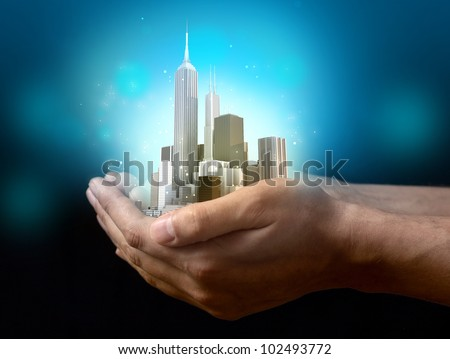 Business city center on hands - stock photo