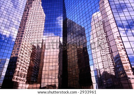 BUSINESS CITY OFFICE BUILDINGS AND ARCHITECTURE REFLECTED BY A BEAUTIFUL BUILDING - stock photo