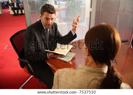 business coaching in an office environment. - stock photo