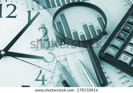 Business collage with magnifying glass, calculator and documents - stock photo