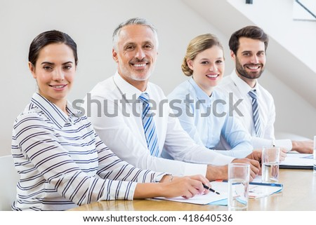 Business colleagues discussing in a meeting at office - stock photo