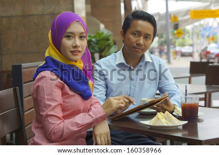 Business Colleagues Eating Meal Together and Discussing of Work - stock photo