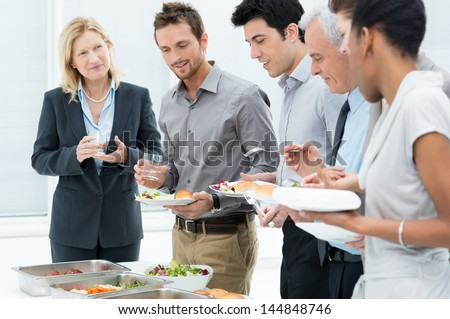 Business Colleagues Eating Meal Together In Restaurant - stock photo