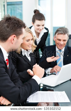 Business - colleagues have a successful meeting in an office - stock photo