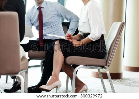 Business colleagues having a team meeting - stock photo