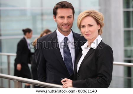 Business colleagues outside the airport - stock photo