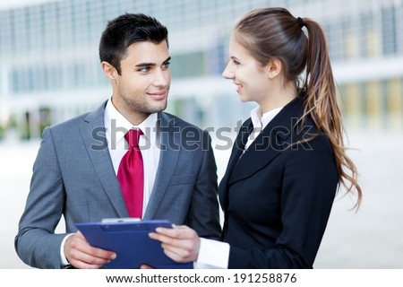 Business colleagues reading a document  - stock photo