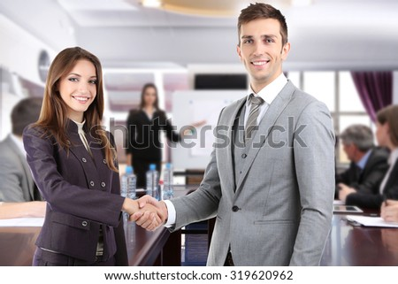 Business colleagues shaking hands and business people
