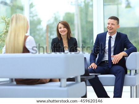 Business colleagues sitting at a table during  meeting with