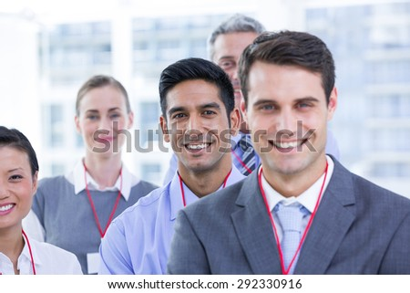 Business colleagues smiling at camera in the office