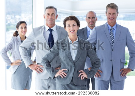 Business colleagues standing in a row in the office