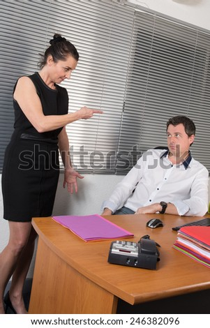 Business Colleagues Working At Desk, working together to achieve good results - stock photo