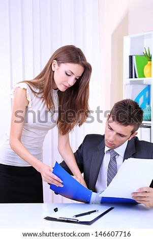 Business colleagues working together in office - stock photo