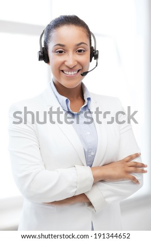 business, communication and call center - african helpline operator with headphones - stock photo