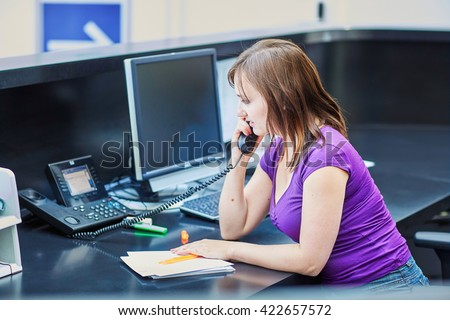 Business, communication and call center concept - beautiful young receptionist at work